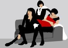 Girls on sofa Stock Photos