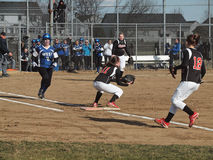 Girls Softball. Batter getting a hit, running to first.   Waukesha West High School girls varsity softball versus  Waukesha South High School, at Waukesha West Stock Photography