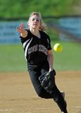 Girls softball - pitcher delivers a pitch Royalty Free Stock Photo