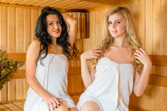 Girls and spa treatments in the Finnish sauna Royalty Free Stock Photo