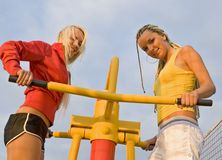 Girls on sport playground Stock Photos
