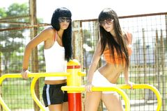 Girls on sport playground Stock Image