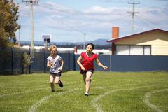 Girls in sports race. Two girls running in a sports race at school Royalty Free Stock Photography