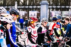 Girls sportsmen at the opening of cycling season. Gomel, Belarus. Gomel, Belarus - April 10, 2016: Beautiful girl bicyclists sportsmen at the opening of cycling Stock Photo