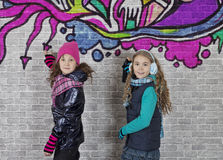 Girls with spray can and wall Stock Photo