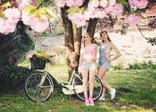 Girls in spring garden Stock Photos