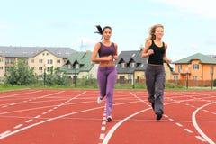 Girls in stadium Stock Images