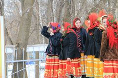 Girls stand aside on the Day of Shrovetide in the city of Kanash, Chuvashia, Russia stock photos