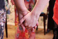The girls stand in a circle and hold hands. course on teaching esoteric techniques. adjustment for work. The girls stand in a circle and hold hands. course on royalty free stock photography