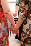 The girls stand in a circle and hold hands. course on teaching esoteric techniques. adjustment for work. The girls stand in a circle and hold hands. course on stock image