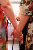 The girls stand in a circle and hold hands. course on teaching esoteric techniques. adjustment for work. The girls stand in a circle and hold hands. course on stock photos