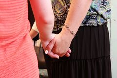 The girls stand in a circle and hold hands. course on teaching esoteric techniques. adjustment for work. The girls stand in a circle and hold hands. course on stock photo