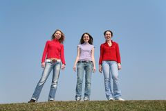 Girls stand on meadow Stock Image