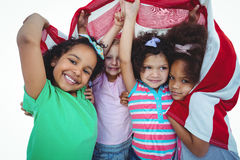 Girls standing with american flag overhead Stock Images