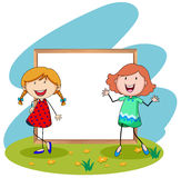 Girls standing in front of white board Stock Image