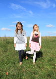 Girls standing in grass Royalty Free Stock Photography