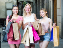 Girls standing with shopping bags Royalty Free Stock Image