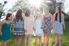 Girls Standing Together With Trees in the Background Royalty Free Stock Images