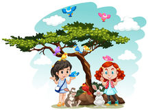 Girls standing under the tree Royalty Free Stock Photo