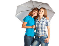 Girls are standing under the umbrella Stock Images
