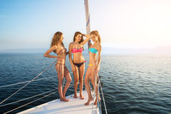 Girls standing on yacht deck. Royalty Free Stock Photography