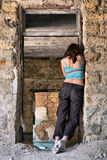 Girls stands in despair. In abandoned house Stock Image
