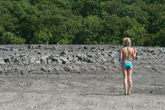 Girls stands at mud vulcano. Stock Images