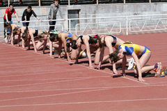 Girls on the start of the 100 meters race Royalty Free Stock Images