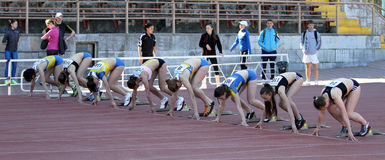 Girls on the start of the 100 meters race Stock Image
