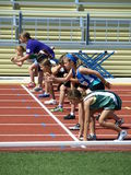 Girls on the start. KAMLOOPS, CANADA - JULY 23 : girls on the start of the 100 meters dash on the BC Junior Development Track and Field Championships July 23 Royalty Free Stock Photos