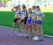 Girls on the start of the 400 meters race Royalty Free Stock Photos