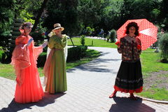 Ladies doing pantomime. Girls statues in period costumes on Childrens Day in Cismigiu park,Bucharest,Romania Royalty Free Stock Photos