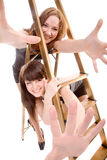 Girls with stepladder Stock Photo