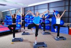 Girls stepping in a fitness center Stock Photos
