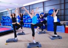 Girls stepping in a fitness center Royalty Free Stock Photography