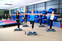 Girls stepping in a fitness center Stock Images