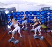 Girls stepping in a fitness center Royalty Free Stock Image
