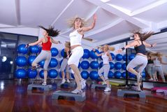 Girls stepping in a fitness center Royalty Free Stock Photo