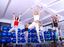 Girls stepping in a fitness center Stock Photo