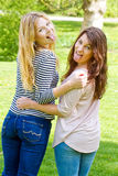 Girls sticking tongue out. Young, modern women sticking tongue out Royalty Free Stock Images