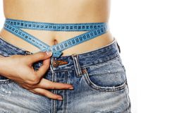 Girls stomach measuring with tape twice isolated. Close up Stock Image