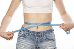 Girls stomach measuring with tape twice isolated Stock Photo