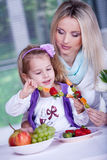 Girls with strawberries Royalty Free Stock Photography