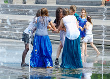 Girls in street fountain. Royalty Free Stock Image