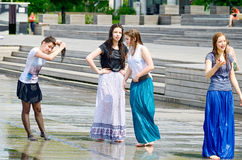 Girls in street fountain. Stock Images