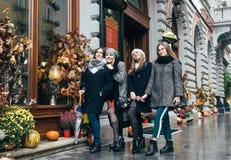 Girls on street. LVIV, UKRAINE - 27 October 2017: Four young girls posing on street Stock Photos