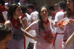 Girls on the street in San Fermin Pamplona. Girls on the street with wine stained clothes in Pamplona San Fermin days - for editorial use Royalty Free Stock Photos