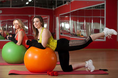 Girls stretching on fitballs Royalty Free Stock Image