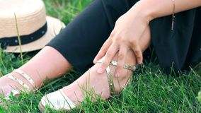 The girls stroking foot. By hand stock footage