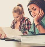 Girls students preparing for exams Stock Photos